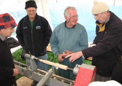Maurice McManus demonstrates the art of Spindle Turning to interested onlookers