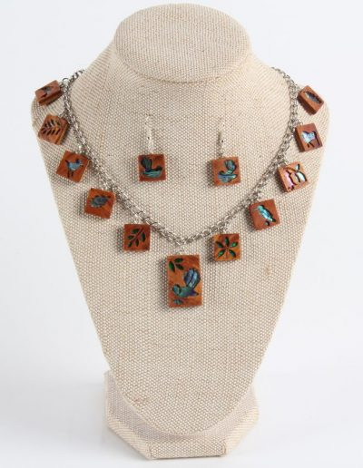 <h4>Highly Commended:</h4><h2> Ross MacDonald</h2><h5> Plant and Animals Necklace and Earrings</h5>